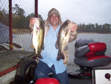 Shane Mattern on a cold December day on Big Sam with a couple of 5 lbers.